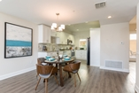 Open floor plan with spacious dining area